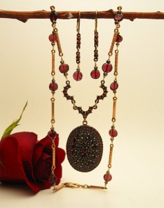 The Bohemian Garnet locket necklace is made with a rare locket from the 1880s all inlaid with gorgeous garnets, antique gold-filled chain links, pyrite and gold-filled findings. $420 (matching earrings)