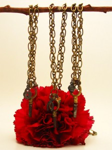 These are all made with base metal chains and antique pocket watch keys and measure 17 inches long. $45 each