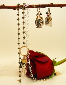The time for love set is made with sterling charms, pyrite, garnets, onyx and sterling and gold-filled findings. $110 (set)